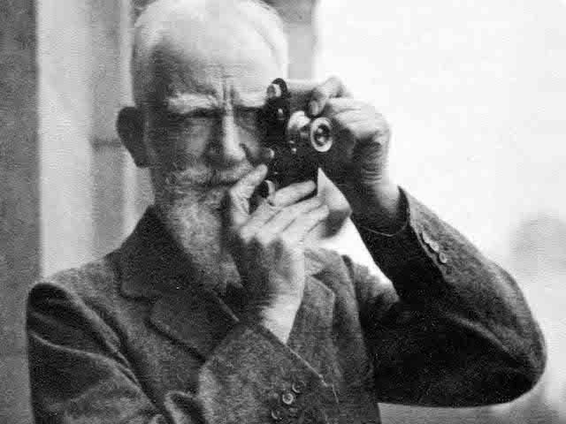 George Bernard Shaw holding Camera